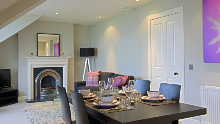 Classy dining area in Q Residence Apartments