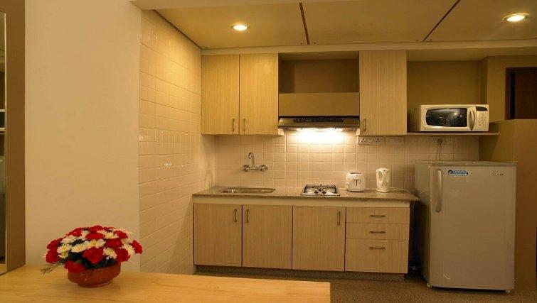 Simplistic kitchen in Brigade Homestead 4 Apartments