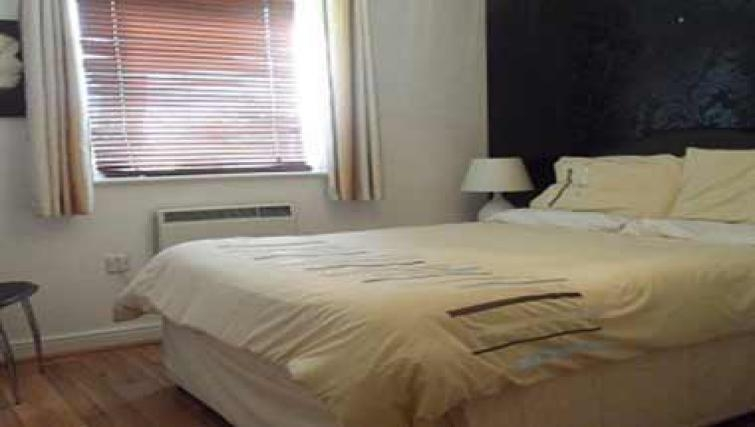 Simplistic bedroom in Coral Apartment