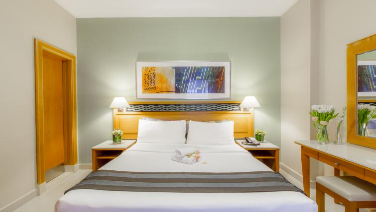 Bed at Golden Sands Apartments