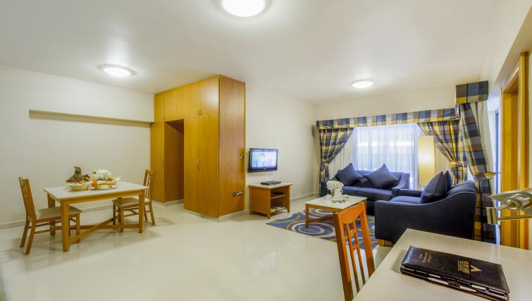 Living space and dining area at Golden Sands Apartments