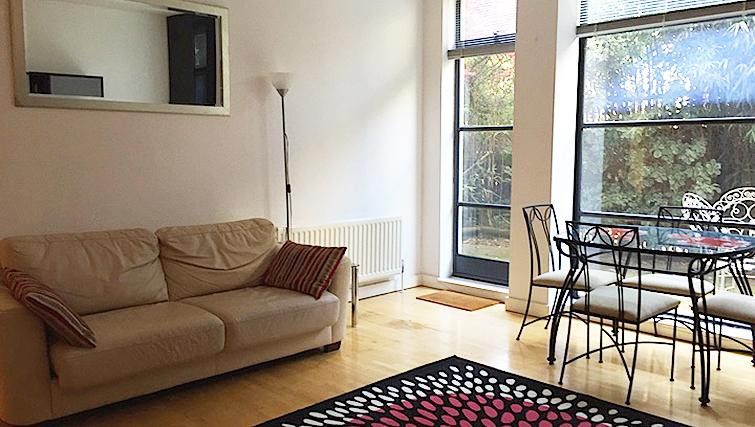 Living/dining area at Chiswick Green Apartment
