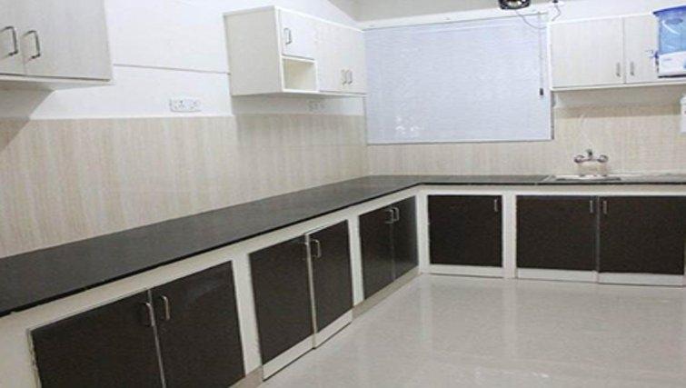 Modern kitchen in Kotturpuram Apartments