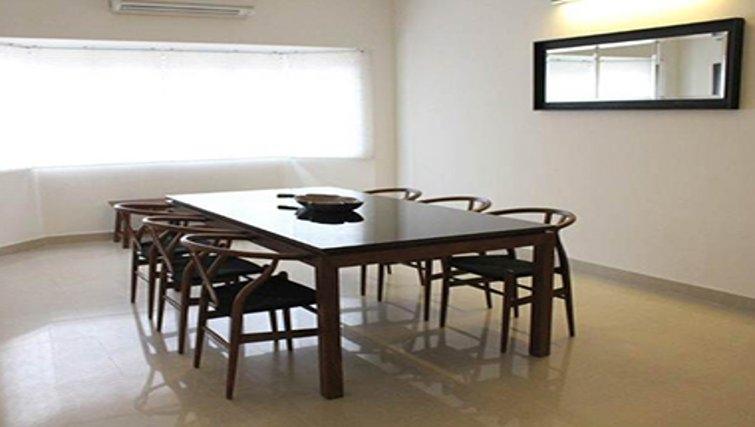 Contemporary dining area in Kotturpuram Apartments