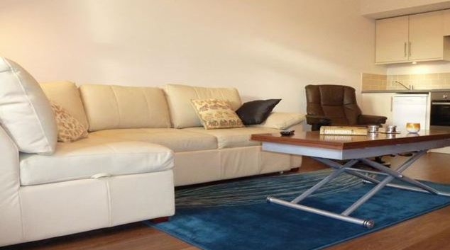 Comfortable living area in Riverside Apartment Hotel