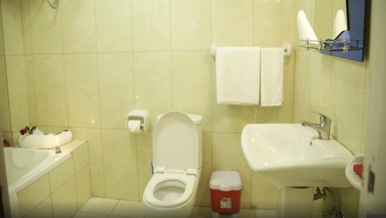Practical bathroom in Riverside Apartment Hotel