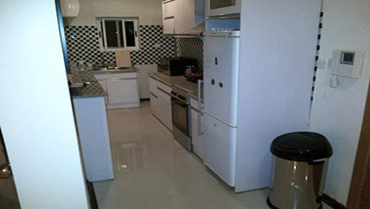 Desirable kitchen in Aart Suites