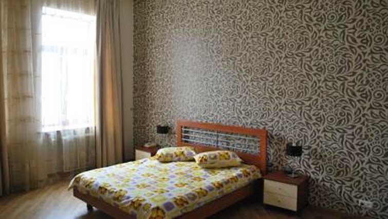 Bedroom at Basseynaya Apartments