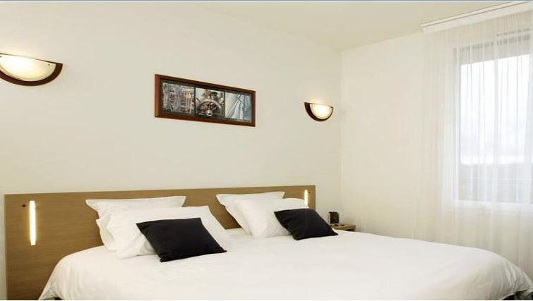 Comfortable bedroom in Appart City Toulouse Labege