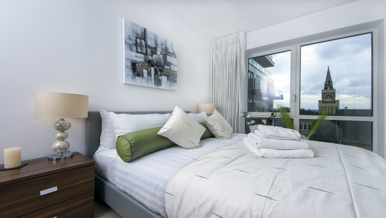Bright bedroom in Dickens Yard Apartments