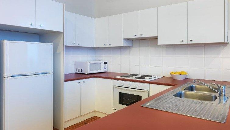Bright kitchen in Adina Apartment Hotel Melbourne, Flinders Street