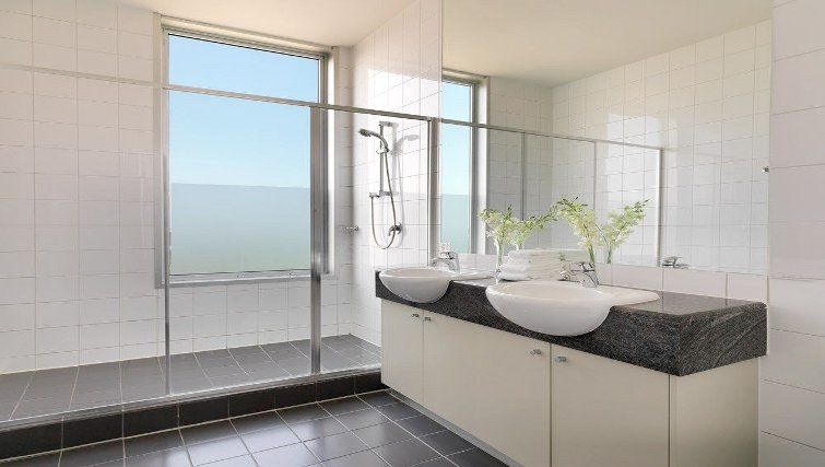 Elegant bathroom in Adina Apartment Hotel Melbourne, Flinders Street