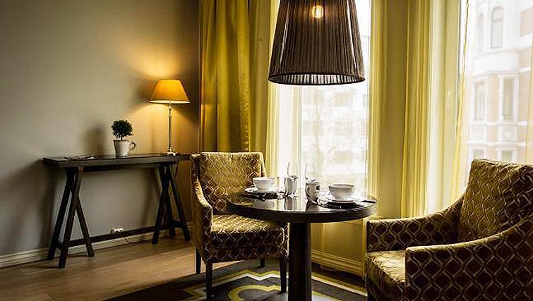 Elegant dining area in Skovveien Apartments