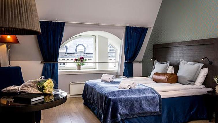 Stylish bedroom in Skovveien Apartments