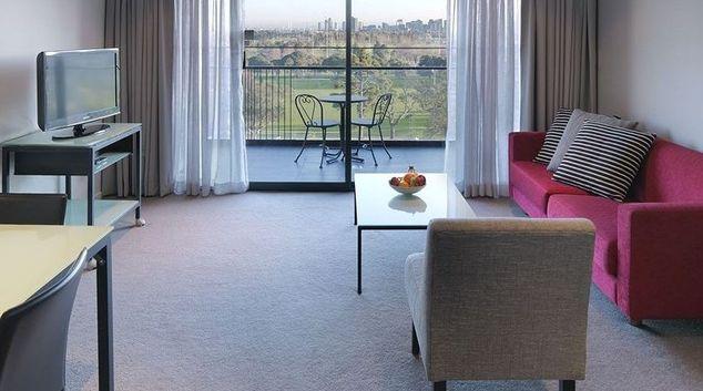 Open plan living area in Adina Apartment Hotel Melbourne, St Kilda