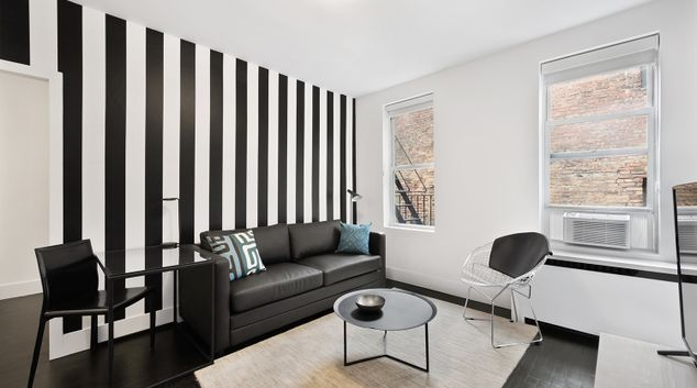 Living room at 221 West 16th Street Apartments
