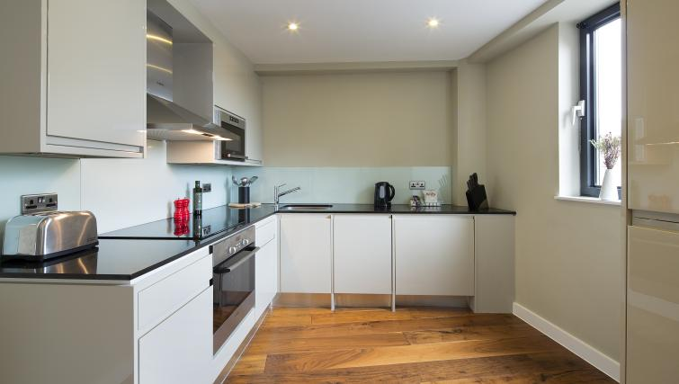 Fully equipped kitchen at Victoria by Q Apartments