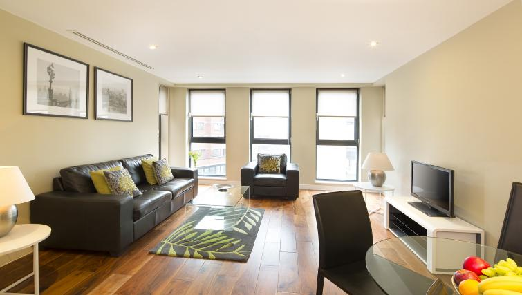 Comfortable living area at Victoria by Q Apartments