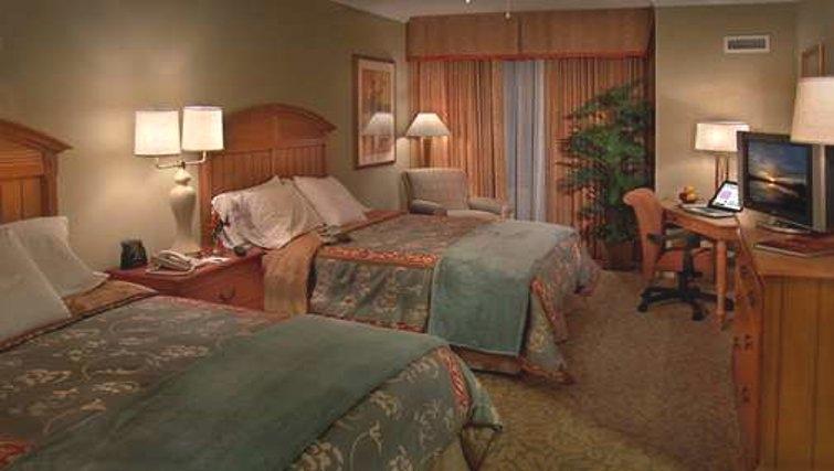 Comfortable bedroom in Homewood Suites Palm Beach Gardens