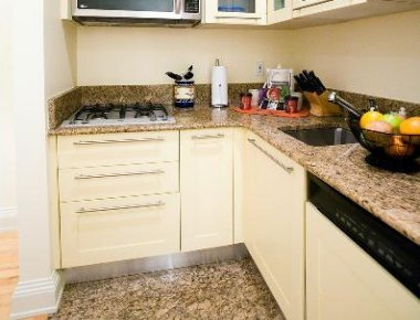 Compact kitchen in 25 East 38th Street Apartments
