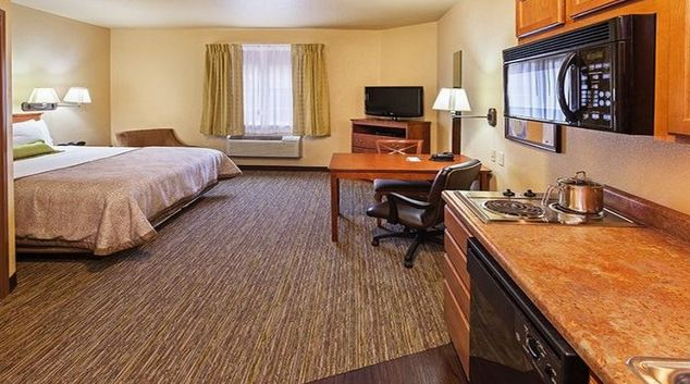 Spacious living area at Candlewood Suites Tulsa