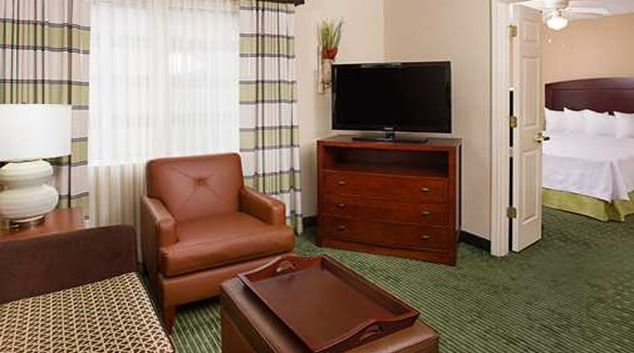 Modern living area at Homewood Suites Dallas Market Center.