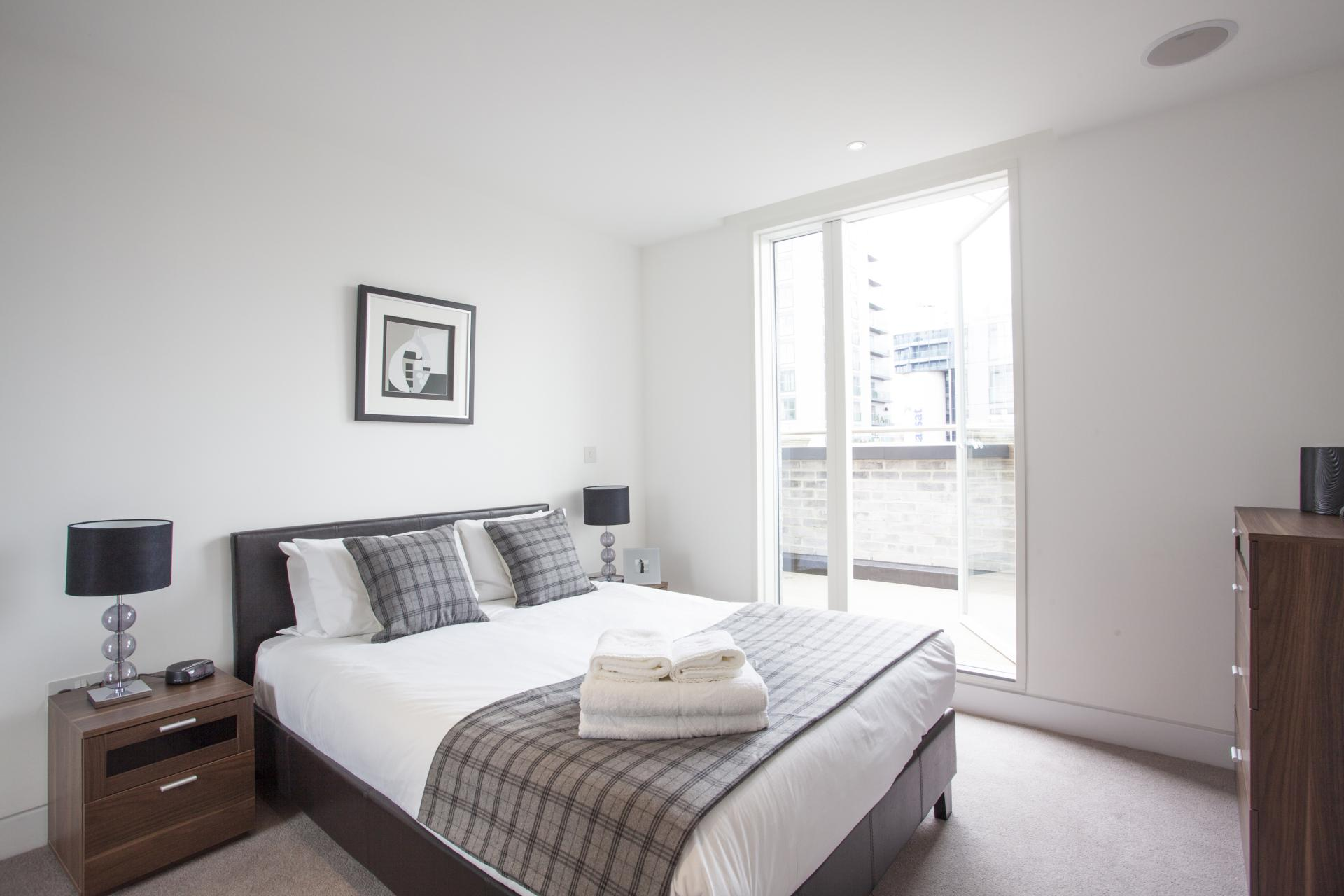 Bedroom at London Square Apartments