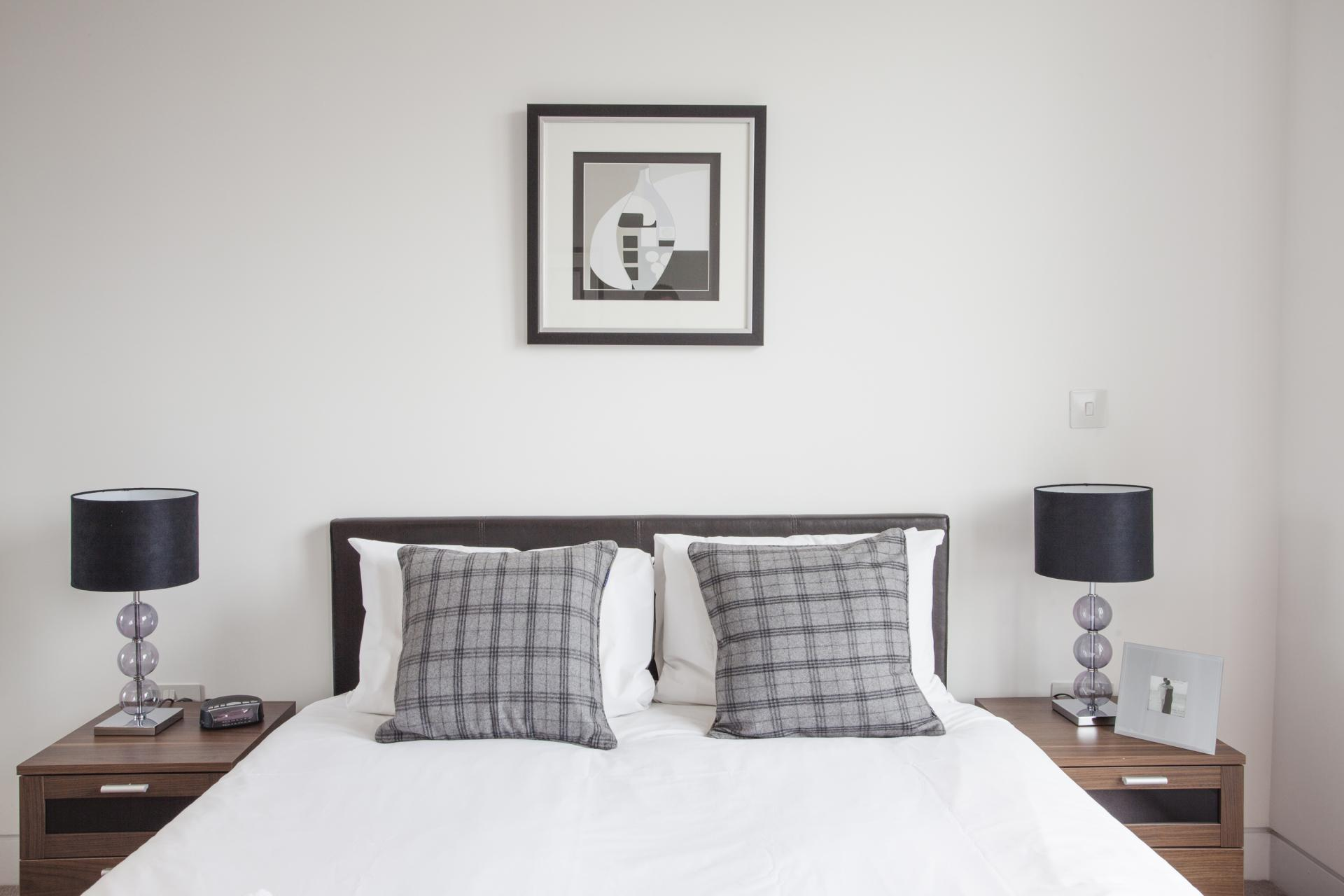 Comfortable bedroom at London Square Apartments