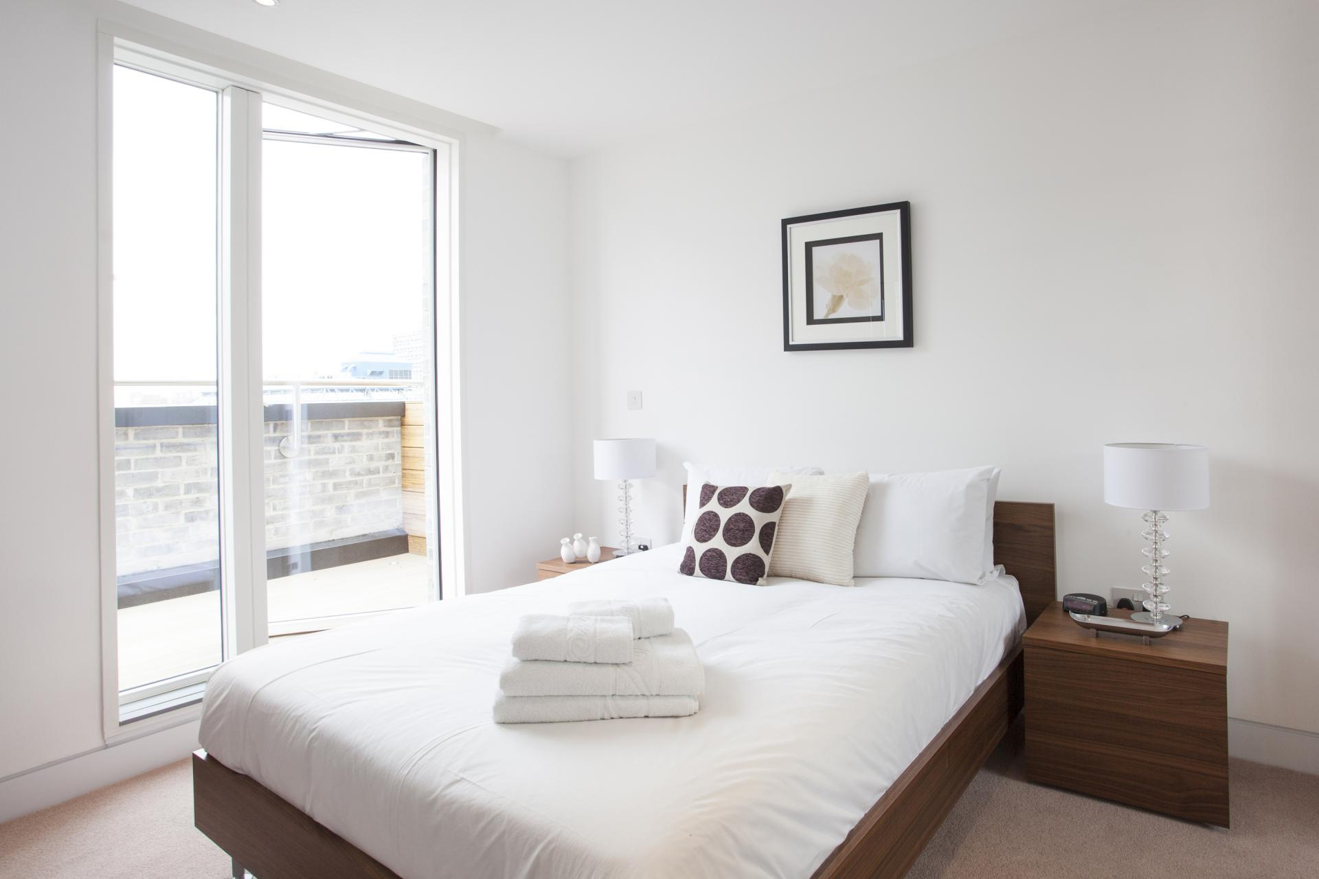 Bright bedroom at London Square Apartments