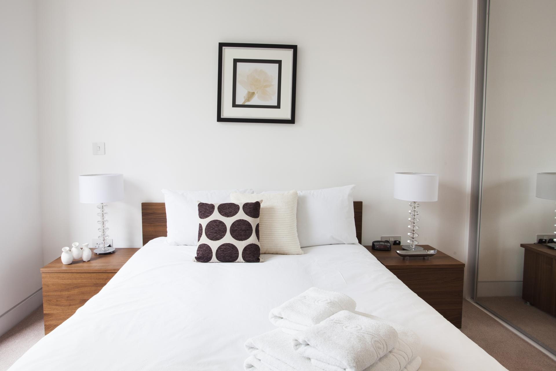Double bed at London Square Apartments