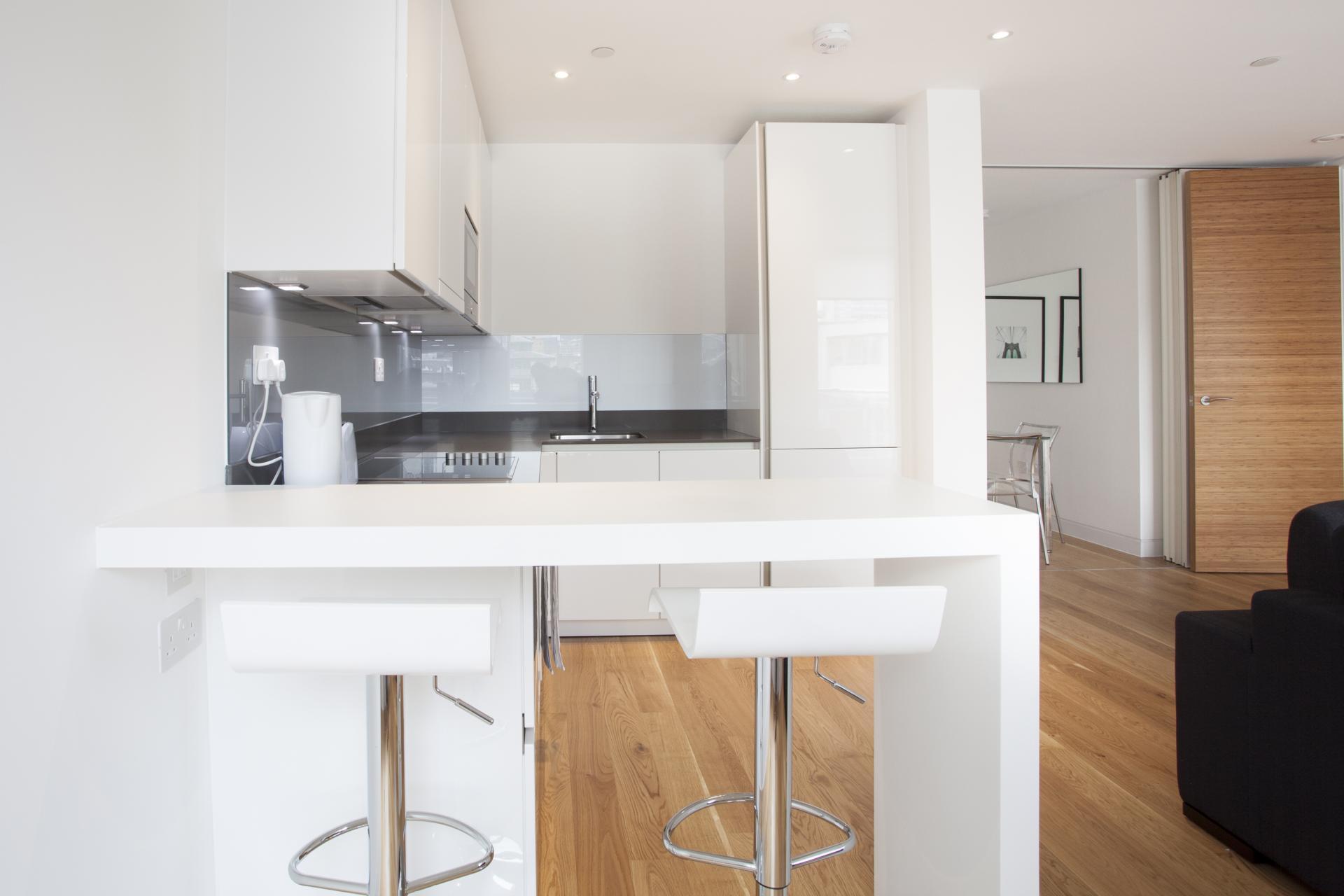 Sleek kitchen at London Square Apartments