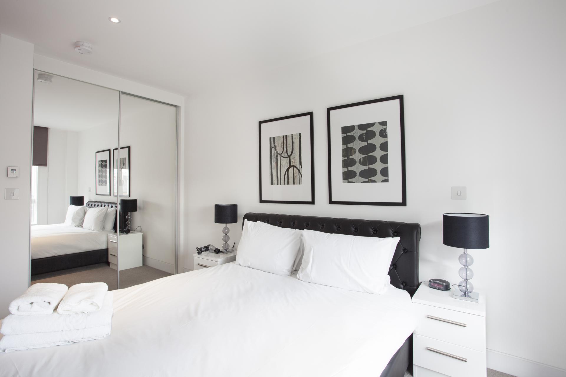 Stylish bedroom at London Square Apartments