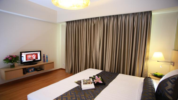 Comfortable bedroom at Somerset Ho Chi Minh Apartments