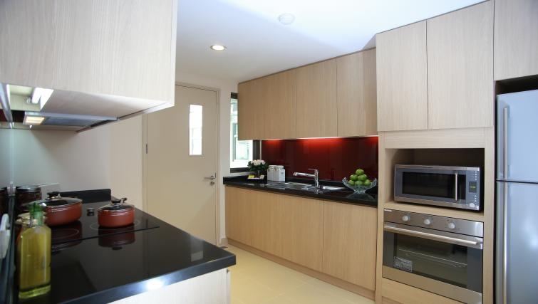 Equipped kitchen at Somerset Ho Chi Minh Apartments