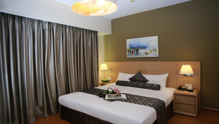 Bed at Somerset Ho Chi Minh Apartments