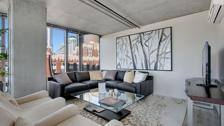 Stylish living area in The Post Seattle Apartments