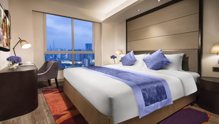Tasteful bedroom in Somerset Xu Hui Apartments