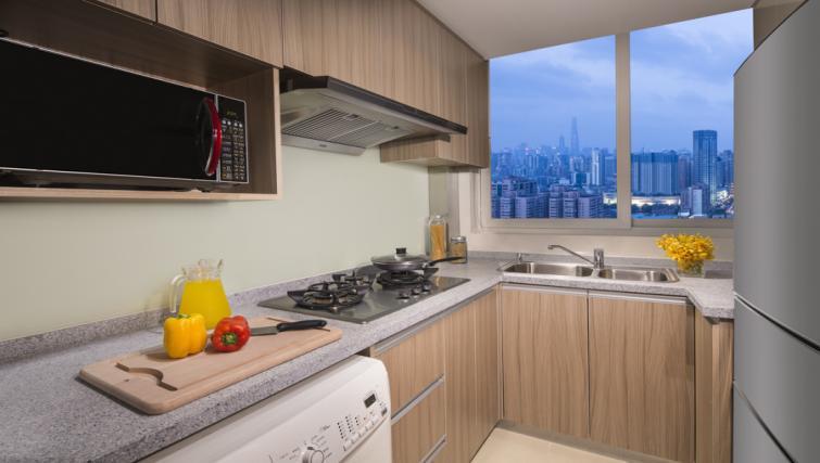 modern kitchen at Somerset Xu Hui Apartments