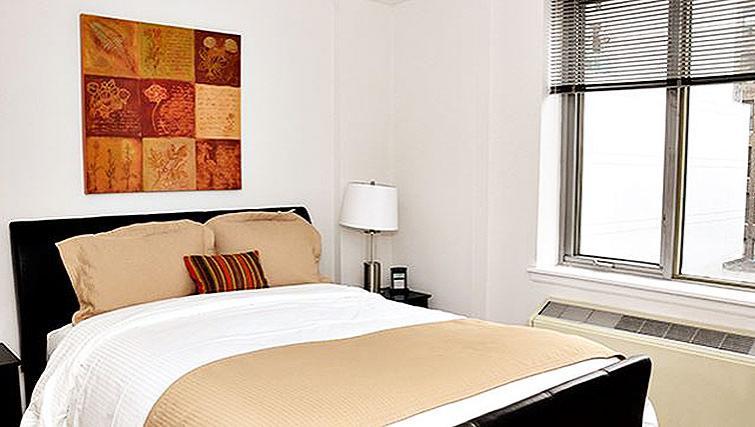 Elegant bedroom in 120 West 21st Street Apartments