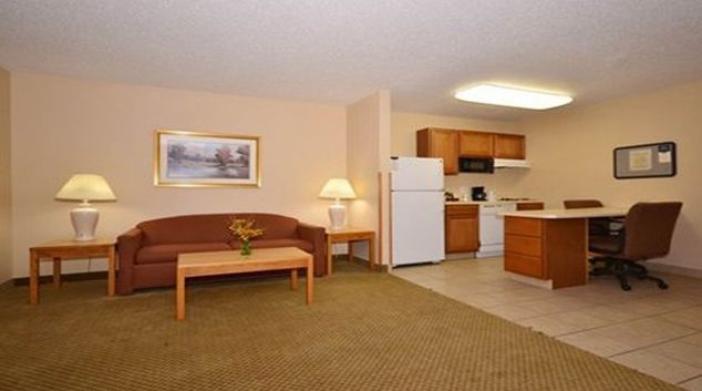 Spacious living area in MainStay Suites Cedar Rapids