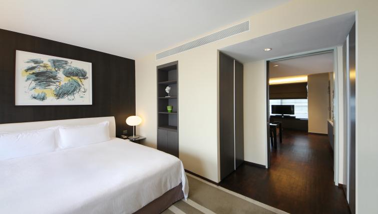 Double bedroom at Pan Pacific Serviced Suites Orchard, Singapore