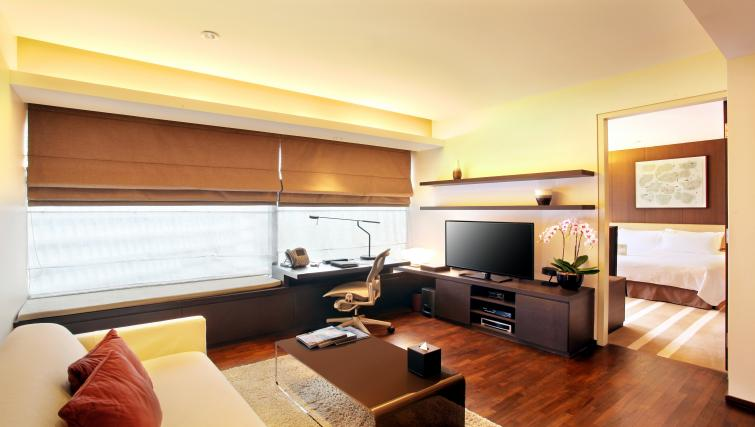 Living space at Pan Pacific Serviced Suites Orchard, Singapore