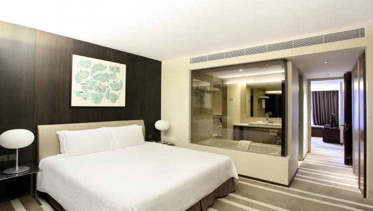 Bright bedroom at Pan Pacific Serviced Suites Orchard, Singapore