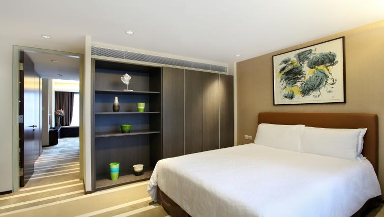 Comfy bed at Pan Pacific Serviced Suites Orchard, Singapore