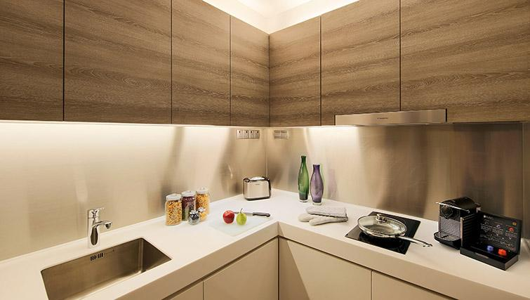 Equipped kitchen at Pan Pacific Serviced Suites Beach Road, Singapore