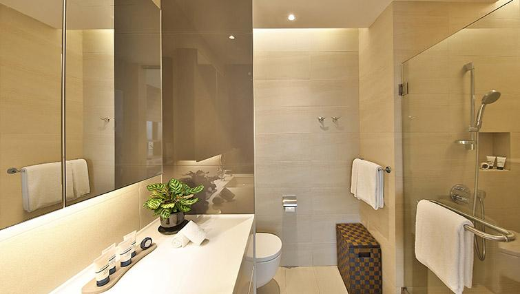 Full bathroom at Pan Pacific Serviced Suites Beach Road, Singapore