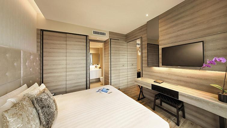 Cosy bedroom at Pan Pacific Serviced Suites Beach Road, Singapore