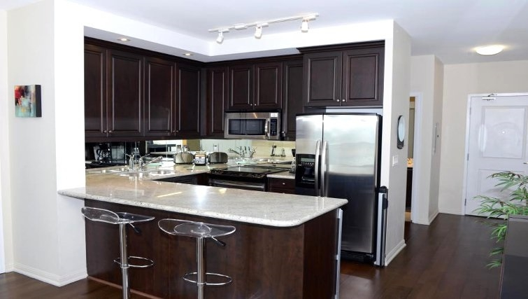 Equipped kitchen in West Harbour City Apartment