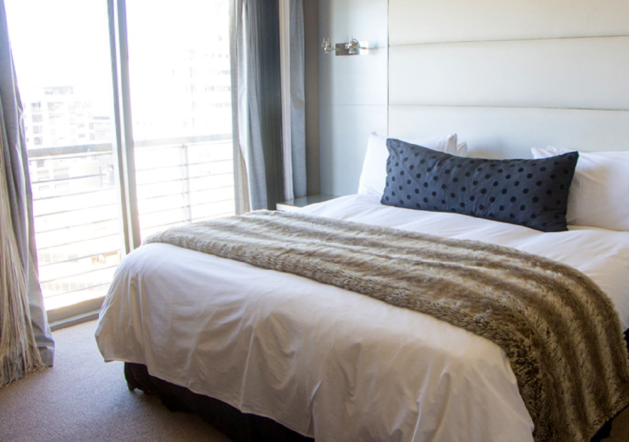 Bed in Icon Apartments