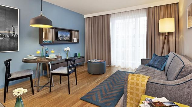 Living area at Citadines City Centre Apartments